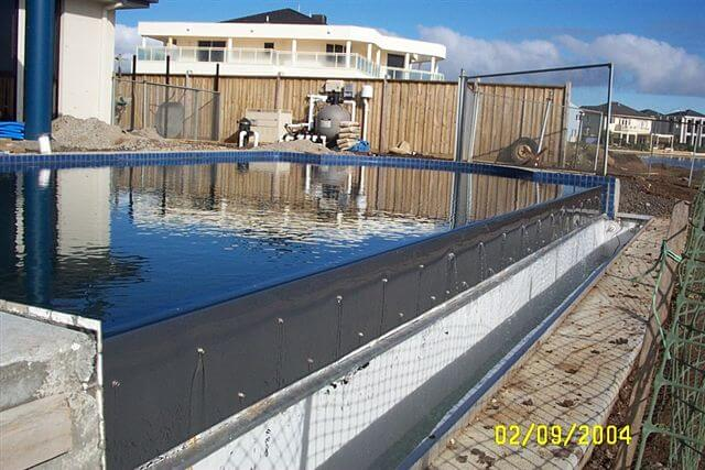 How Much Does an Infinity Edge Swimming Pool Cost? - Compass Pools ...