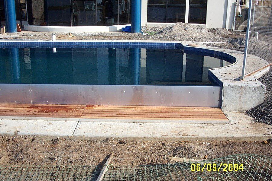 How much does an infinity edge swimming pool cost for Pool construction cost